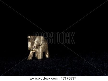 UMEA, SWEDEN ON DECEMBER 19. View of a souvenir, an elephant on December 19, 2013 in Umea, Sweden. Black background. Illustrative Editorial