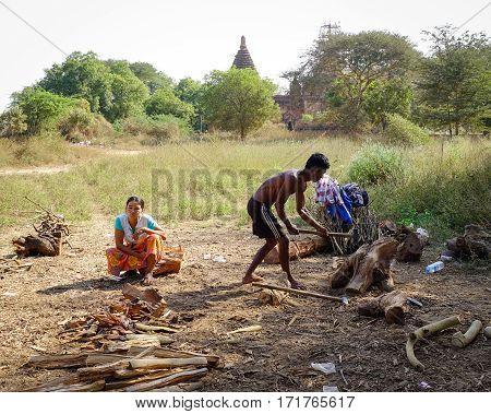 People Split Firewood In Bagan, Myanmar