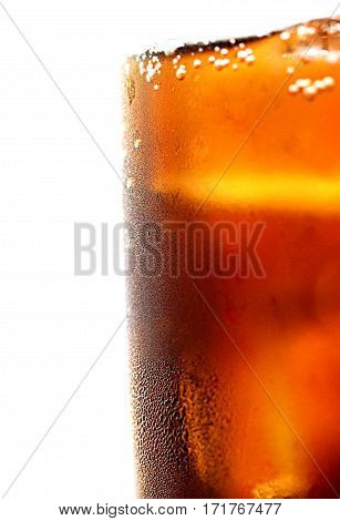 Glass of cola with ice cold refreshing soft drink with ice on an isolated white background