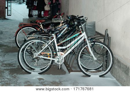 Bicycles parked in the snow near campus