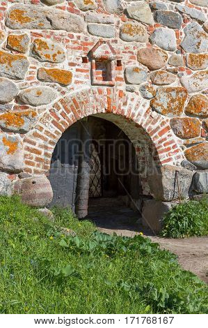 Entrance gate in the old wall of the monastery. Architecture exterior