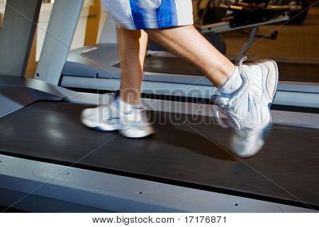 Close Up of Man Running on Treadmill