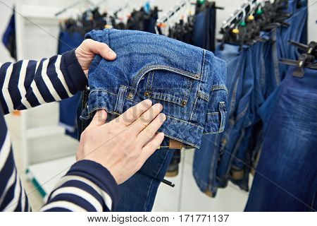 Buyer Chooses Jeans In Store
