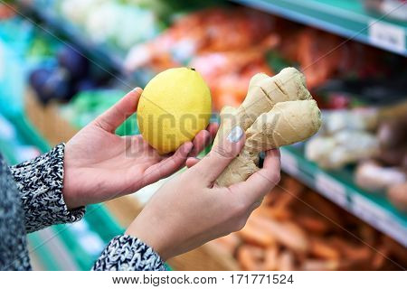 Woman Buyer Selects Lemon And Ginger In Store