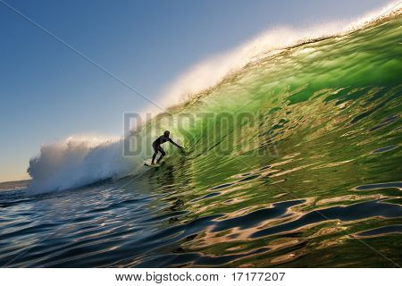 Surfer on Sunset Wave in California