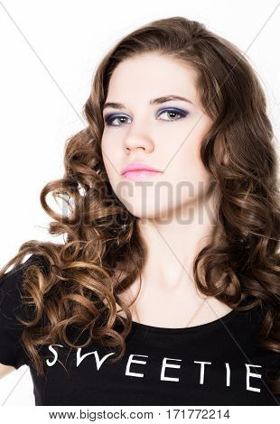 Young beautiful curly girl with professional make-up.