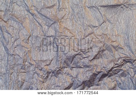 Background of silver and golden wrinkled crepe tissue paper
