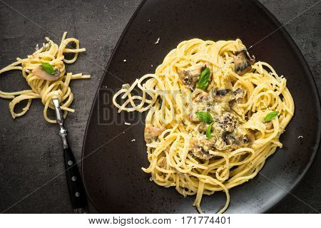 Pasta spaghetti with mushrooms and white sause with basil. Traditional italian food.