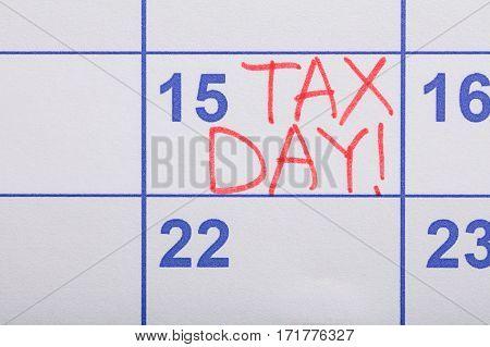 Close-up Of Tax Day Written On Calendar Date
