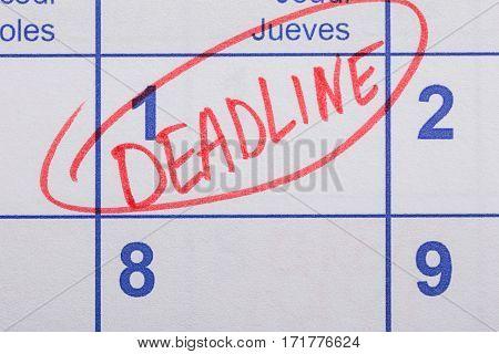 Close-up Of Word Deadline Written On A Calendar Date