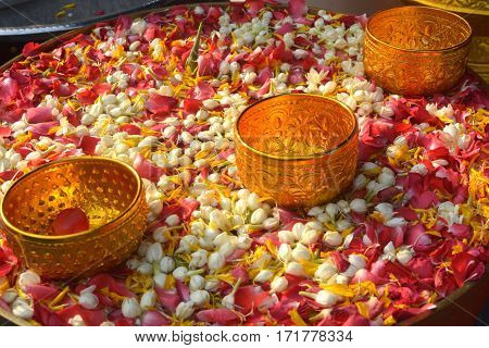 Water in bowl mixed with perfume and flowers Songkran festival in Thailand.