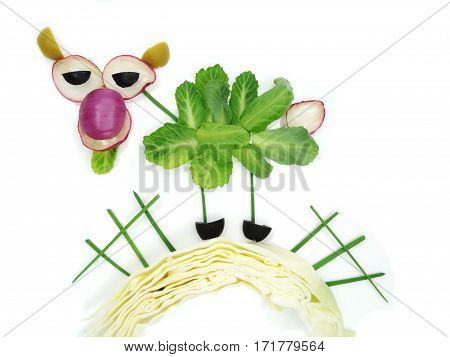 creative funny vegetable food snack with cucumber cow form