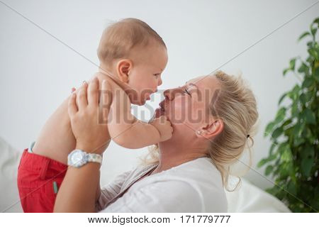 mom with baby in hands