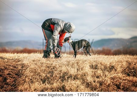 Child outside with dog playing