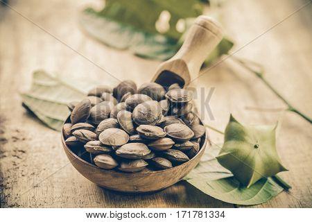 dried capsule seeds fruit of Sacha Inchi peanut in basket on dish