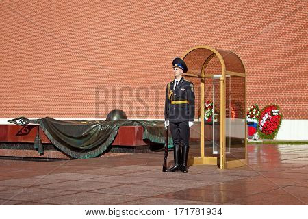 MOSCOW, RUSSIA - MAY 2016: Changing guard soldiers in Alexander's garden near eternal flame in Moscow, Russia