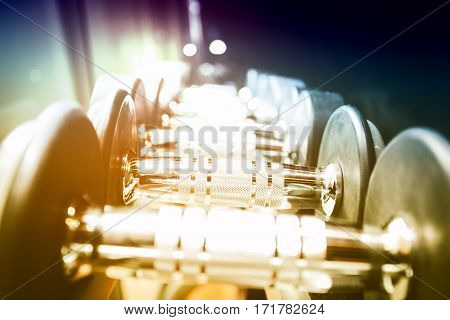blurred Image Rows of dumbbells in the gym