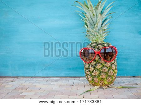Pineapple with funny heart sunglasses vacation concept