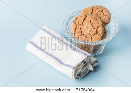 Chocolate chip cookies in a glass cup with napkin