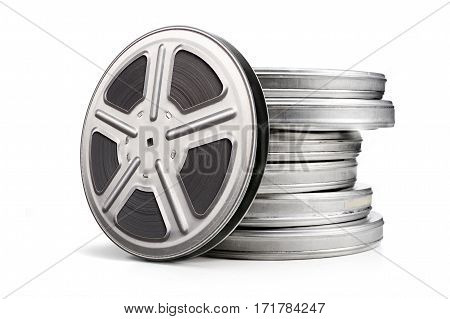 Movie canisters isolated on a white background. Pile of film reel cans.