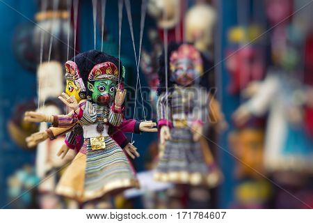 Masks dolls and souvenirs in street shop at Durbar Square in Kathmandu Nepal.