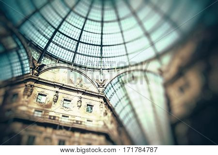 Glass dome of Galleria Vittorio Emanuele II shopping gallery. Milan Italy.