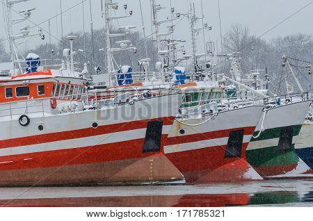 FISHING PORT IN KOLOBRZEG - Fishing boats on the waterfront in the winter port
