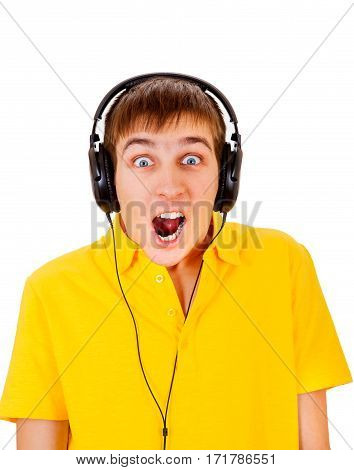 Surprised Young Man in Headphones listen to the Music Isolated on the White Background