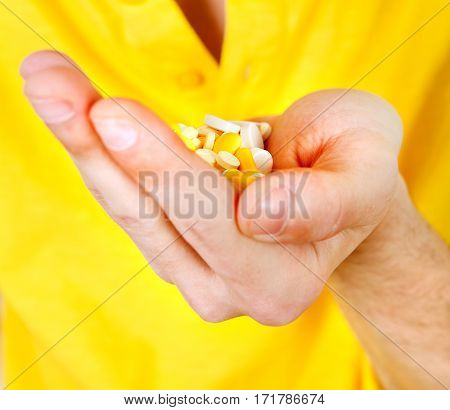Person hold a Pills in the Hand closeup