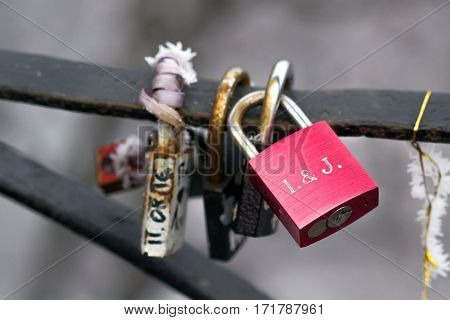 Locks on the railing of the bridge symbolizing love and loyalty