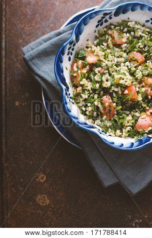 Vegetarian salad with bulgur mint tomato vertical