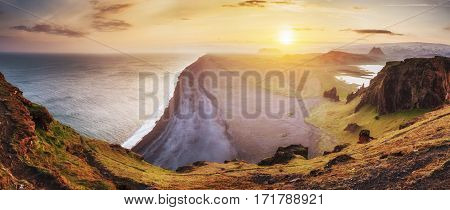 Landscape with ocean and Reynisfjall mount Iceland