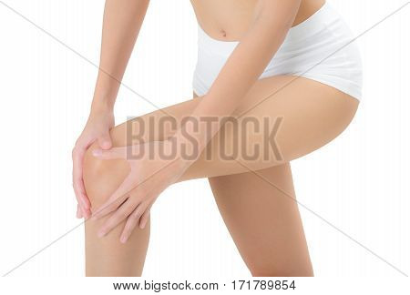 woman holding her beautiful healthy long leg with massaging knee in pain area Isolated on white background.