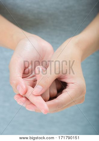 woman holding her beautiful healthy hand and massaging index finger in pain area Isolated on white background.