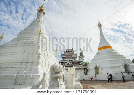MAE HONG SON, THAILAND - JAN 2, 2017: Many people visit Burmese-style chedi of Wat Phra That Doi Kong Mu in Mae Hong Son, Thailand.