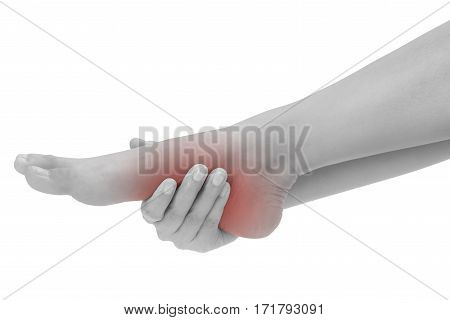 woman hands holding beautiful healthy foot and massaging in pain area black and white color with red highlighted Isolated on white background.