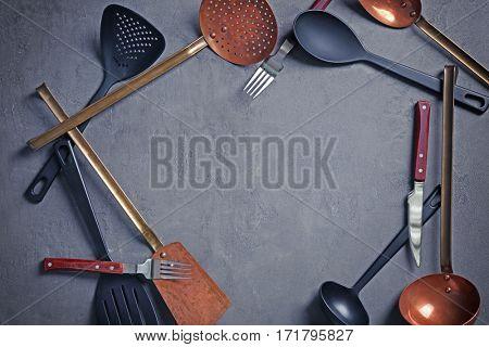 Kitchen utensils on grey background