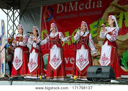 GOMEL BELARUS - MARCH 12 2016: Performance of creative choral collective. Concert was conducted in open air with open free access for all comers during mass Shrovetide celebrations