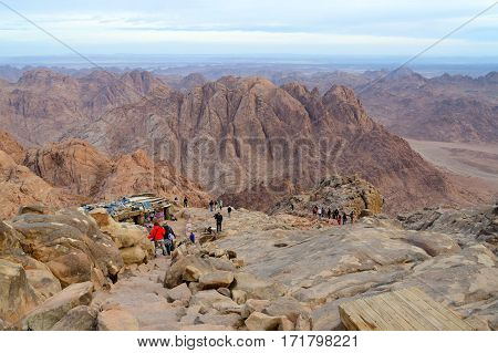 SINAI EGYPT - NOVEMBER 28 2013: Unidentified tourists descend on long path from top of Mount Moses Egypt