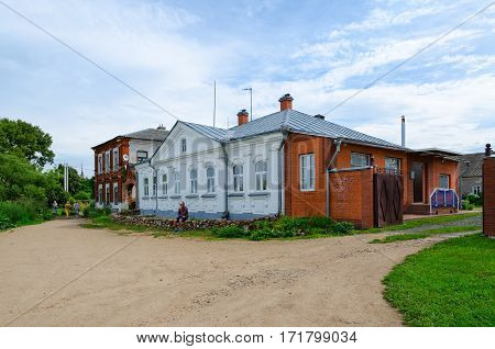 KALYAZIN RUSSIA - JULY 22 2016: Unidentified tourists are near house of princes Shehonskie (XVIII century) in Zarechenskaya part of town Kalyazin Russia