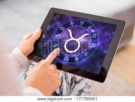 Taurus zodiac sign on tablet computer screen