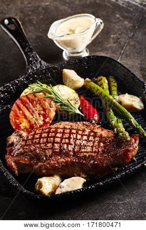 Beef Steak - BBQ Strip Steak (Grilled Beef Strip Loin Steak) with Roast Vegetables and White Sauce