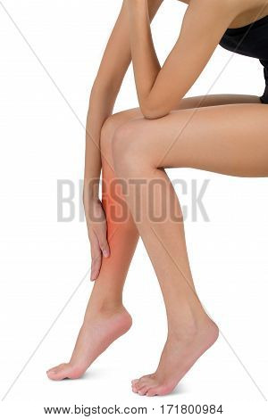 woman sitting and holding her beautiful Healthy long leg with massaging shin in pain area with red highlighted Isolated on white background.