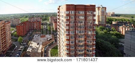 Aerial vies of the newly errected residential buildings and the construction of the underground Parking in their yard. City Balashikha, Moscow region, Russia.