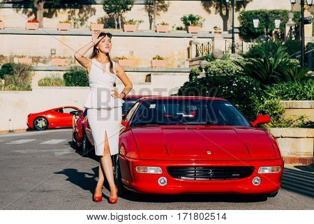 Ferrari show 8 october 2016 in Valletta Malta near Grand Hotel Excelsior. Beautiful young girl near the red Ferrari 355 FI
