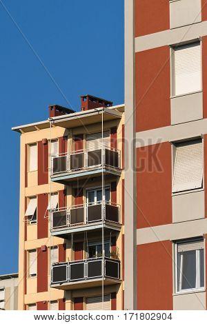 Milan (Lombardy Italy): facades of residential building along via Gattamelata with balconies