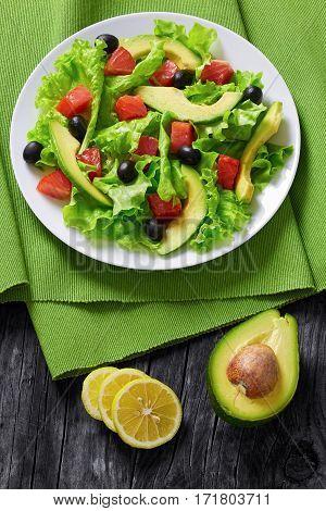 Salmon, Fresh Lettuce, Avocado, Black Olives Salad