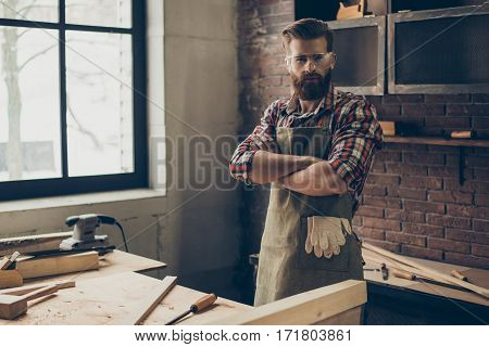 Serious  Joiner Crossed Hands While Standing At His Workstation. Successful Handsome Businessman Wit