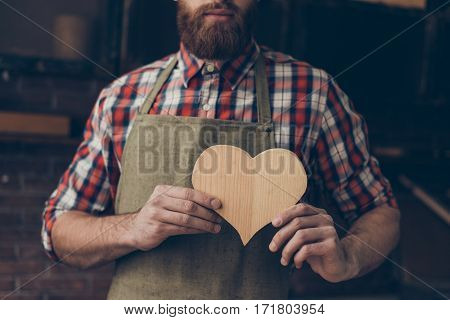 Happy Handsome Joiner In Love Holding And Showing Handmade Wooden Heart. He Love His Job