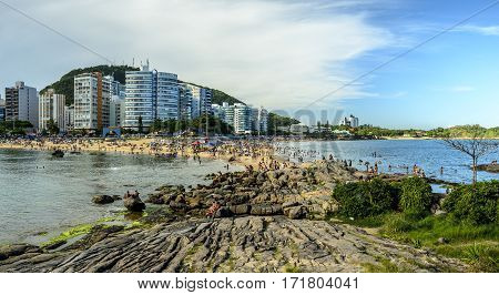 VILA VELHA BRAZIL - DECEMBER 25th 2016 ; Tourists on a crowded Costa and Mermaid Beach in Vila Velha state of Espirito Santo Brazil.